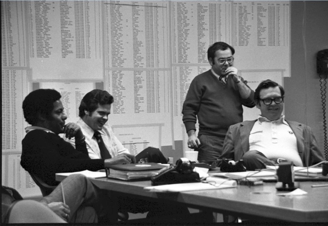 Inside the Steelers' draft room at Three Rivers Stadium with (from left to right) Bill Nunn Jr., Dick Haley, director of player personnel, V. Tim Rooney, a nephew of Art Rooney Sr., and Art Rooney Jr., vice president. Courtesy of the Pittsburgh Steelers.